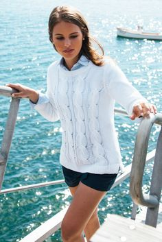 Navy short, light blue sweater, white sweater