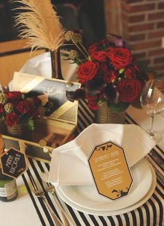 Classy decor with deep reds, navys and black, with gold accents