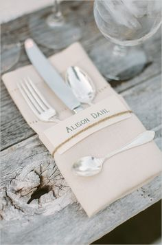 simple place cards on linen napkins, embellished with twine, thin jute or vibrant ribbon?