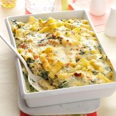 Creamy Spinach & Rigatoni Bake Recipe -Macaroni and cheese is one of the ultimate comfort foods, but go ahead and give an Italian twist here.