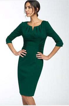 V-neck dress with neck darts, lined bodice, empire waist and ruched skirt.