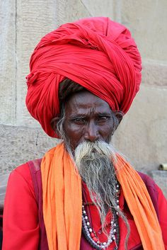 Colorful sadhu on ghat in Varanasi, makes me want to get into photography.