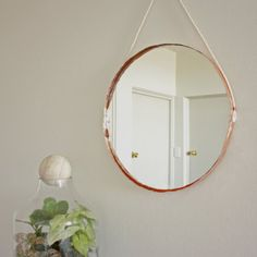This DIY Copper Edged Mirror is easier than it looks and uses an unusual material!