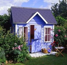 lovely!  Periwinkle blue garden shed with dutch doot