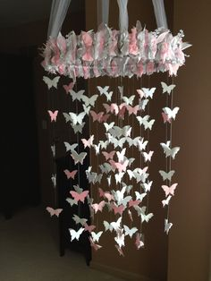 Pink, gray & white #butterfly #mobile! #NuseryDecor #BabyRoom #handmade Another one of my takes on a Pinterest DIY.