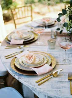 This sophisticated and sweet design features a blush sequined runner on a white-washed round farm table from @southernevents with gold chargers and gold-rimmed china, and a romantic floral centerpiece by @flwrgirlcaprice Champagne coupes filled with rosé add a touch of vintage '20s glamour. Perfect for spring reception the garden at @cjsoffthesquare  Nashville Garden Wedding Venue