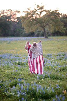 flag in field of flowers