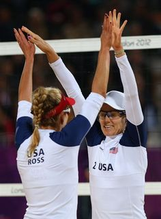 April Ross and Jennifer Kessy of United States celebrate a point during the Women's Beach Volleyball