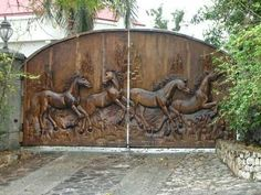 Beautiful front gate with horses