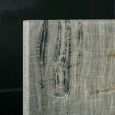 Laminated glass with white fabric