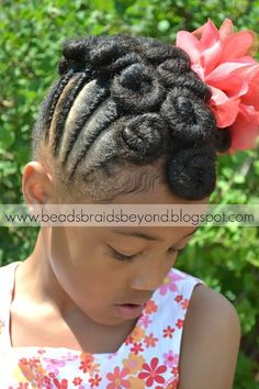 Braids with pin curls.