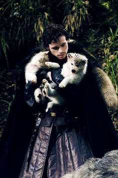 Robb Stark and his dire wolf pup Grey Wind. Cuterness overload!