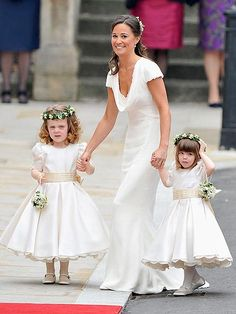 Pippa Middleton holds tight to both 3-year-old attendants