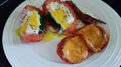 Baked tomato filled with spinach and egg