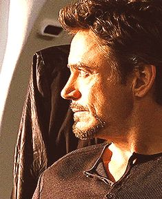 "Tony Stark (he looks so exceptionally beautiful in this scene from ""Iron Man 2"" - must be the lighting...yeah, that's it...)"
