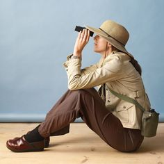 An avid bird watcher keeps an eye on her little owl with a pair of binoculars. Other than the hat and a canteen (available at camping-supply stores), this costume can be assembled entirely from ordinary street clothes: Choose an outfit that consists of neutral, outdoorsy pieces, such as the safari-style jacket and brown pants shown, and don't forget a pair of sensible shoes.