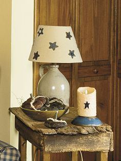 For a star-studded light, glue fabric stars onto a plain lamp shade, or stencil some on with fabric paint. To see more of this photo and find out more about the items shown, turn to page 122 of our September 2014 issue or page 42 of our online Craft Fair, http://www.countrysampler.com/craftfair/flipbook.php?issue_code=C0914