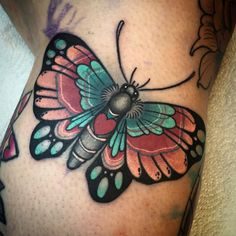 Butterfly on the side of a knee.
