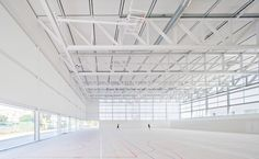 Two enormous translucent walls flood the playing court of this bright white sports centre by Spanish architect Alberto Campo Baeza with dazzling light.