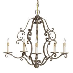 The comfortable elegance of the Montecristo chandelier by Currey and Company is inspired by a Paris flea market find. The aged brass finish gives the wrought iron frame a rich presence with gentle curls in silver leaf adding just the right amount of drama. The chandelier is hand finished using a process that lends an air of depth and richness not achieved by less time-consuming methods.