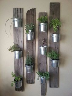 Vertical Gardens indoor herb garden idea: Tin Buckets on Re-Purposed Wood - In this post, we'll share 9 beautiful ways to bring your herb garden indoors, so that you can enjoy fresh herbs all year long. Vertical Garden Wall, Vertical Gardens, Vertical Planter, Wall Garden Indoor, Small Gardens, Garden Wall Art, Vertical Bar, Garden Planters, Planter Pots