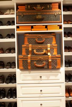 This homeowner's closet includes showcase-quality space for his Louis Vuitton luggage—front and center amidst a carefully organized collection of shoes...