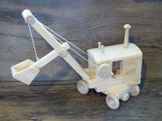 Handmade original design wood toy steam shovel. 19 inches long (with boom down) and 7 inches wide, wheels all turn, cab swivels 360 degrees, bucket