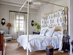 alessandra branca bahamas - tropical white bedroom with canopy bed