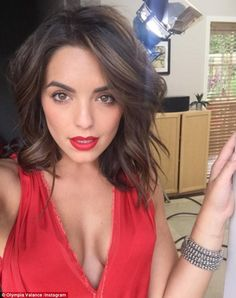Flawless: Olympia Valance stunned in her latest social media post on Thursday as she dressed her toned curves in a vibrant red dress which featured a plunging neckline