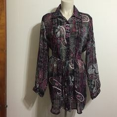 Sheer paisley blouse Black, fuchsia , white, and gray paisley print button-up blouse. Pleats on the bosom area. Billowing long sleeves. Tie around the waist to add a little drama. A nice work blouse that goes with a nice long pencil skirt or a pair of slacks. Dots Tops Blouses