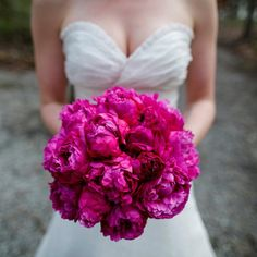 The bride will carry a bouquet of fuchsia peonies wrapped in gold ribbon with the stems showing.