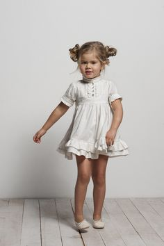 ruffly babydoll dress and space buns for a little girl