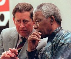 South African President Nelson Mandela talks with Prince Charles in Brixton, south London, on the last day of Mandela's four-day state visit to the United Kingdom. Media reports in Britain said Prince Charles' wife, Princess Diana, had accepted divorce terms last week, but that Buckingham Palace wanted to wait until Mandela finished his visit before making an announcement. Photo: Getty Images