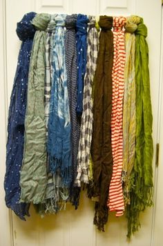 (towel bar to store scarves)  I decided to do this in my closet and since my closet is organized using all the white wire closetmaid stuff, I used one of those cheap white curtain rods.  Worked like a charm, matches perfectly and costs on 3 bucks!  I <3 pinterest!>>>I know someone who could use this...<