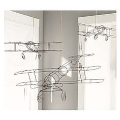 These wire planes would look fab hanging in a little boys bedroom!