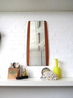 An elegant Danish teak wall mirror . Would look great in Contemporary setting.  Item Specifics NR273  Height: 78.5cm (approx 30.50) Width: 35cm (approx
