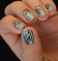Check out these fun black and white styled digits! @blognailedit #mani