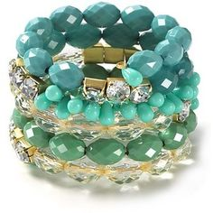 Aqua, turquoise, teal, and olive in a five-row beaded boho-chic bracelet.