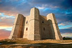 "http://www.apuliadestination.com/itinerari/ Castel del Monte - Italia (Puglia) Built about 1240. ""It is a unique masterpiece of medieval military architecture reflecting the humanism of its founder: Frederick II of Hoenstaufen""."