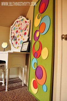 This is a great idea for outside art that looks modern, can stand up to the elements and won't cost much. All Things Thrifty turned large plastic lids into wall art.