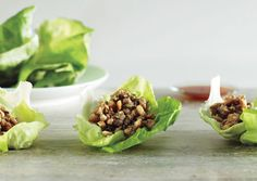 """Lettuce Cups with Stir-Fried Chicken  The trick to a successful stir-fry? Have all your ingredients prepped so that you can cook quickly over high heat. In professional kitchens it's called mise en place, or """"put in place."""""""