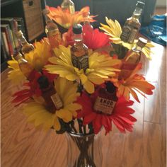 Birthday Bouquet of Booze that I made for Steve! Used hot glue to attach mini bottles to dowel rod, and then slipped on petals from fake flowers.