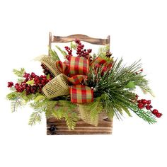 Perfect as a festive centerpiece or sideboard accent, this faux holiday-themed basket features lifelike berries and evergreen branches.