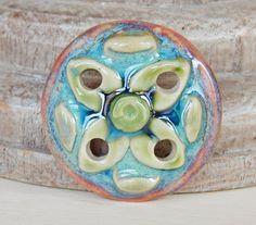 Porcelain ,flower pendant . By Mª Carmen Rodriguez ( Majoyoal ) https://www.facebook.com/groups/CeramicArtBeadMarket/