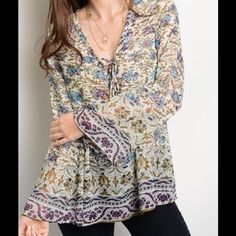 Did someone say Spring This beautiful mixed print top has long bell sleeves and a relaxed fit. 100% Polyester. A61 Tops Blouses