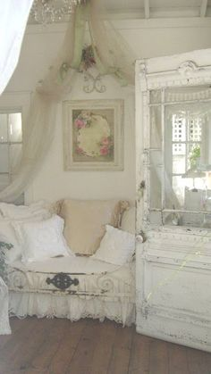 LOVE the sheer draped from and twined among the chandelier- lovely shabby chic, vintage, cottage look