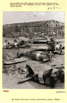 Wrecked Macchi C.200, C.202, Fiat G.50, Cr.42 victims of bombing and strafing lie piled up on Castel Benito Airfield, early 1943. Castel Beinto was renamed RAF Idris after being captured, notice the three P.38s landing
