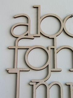 awesome wooden alphabet design, for a children's room or maybe craft room. available on Etsy.