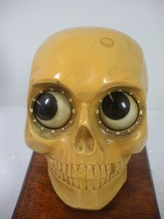 This rare, rotating eye skull clock was made in West Germany in the 1920's. Created from an organic resin compound, the eyes rotate to tell the time.