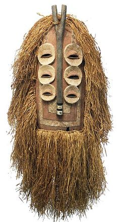 Africa | Bembe people, DR Congo ~. Elanda mask | From the Elanda male association, most often have a rounded top and a flat bottom, with a spiritual, mysterious, but human face. Some with rounded faces are similar, but those with pointed beak-like chins and small tufts or horns represent bird or animal spirits. Several , like this one, have multiple sets of eyes. | © Tim Hamill